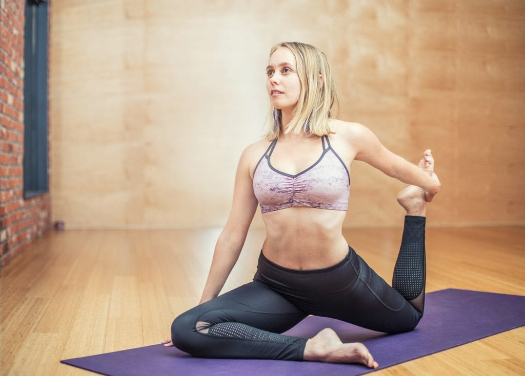 Woman doing yoga stretches