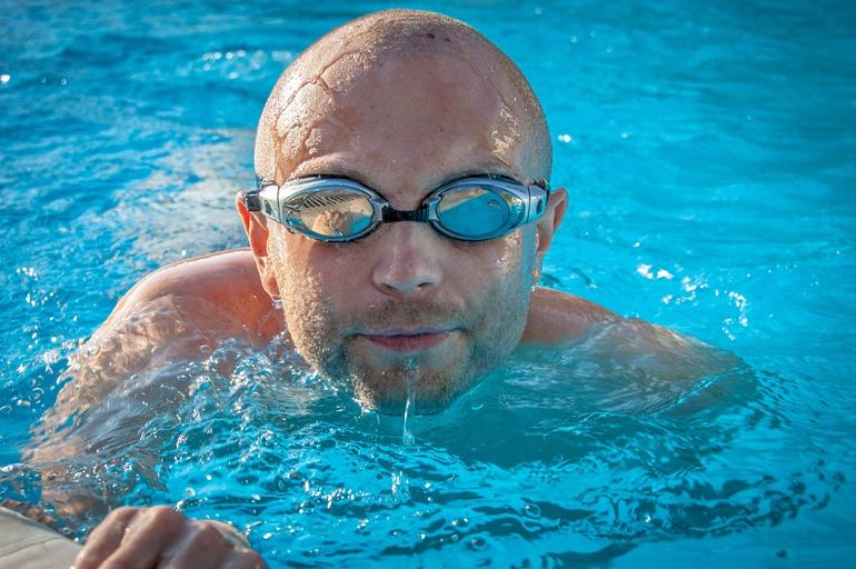 man swimming for workout